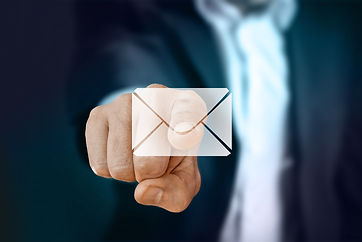 Finger clicking on email icon