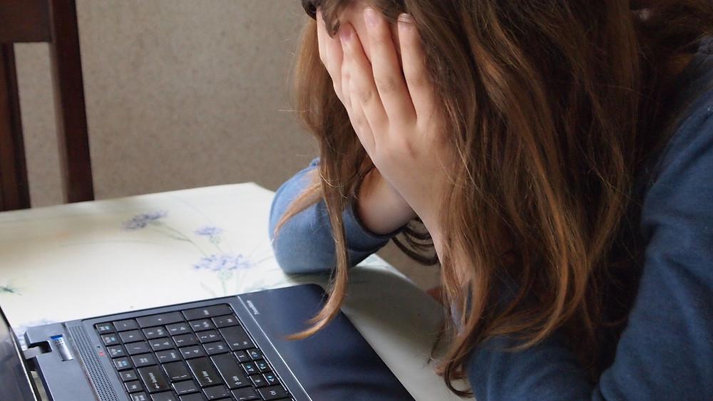 Girl being bullied online