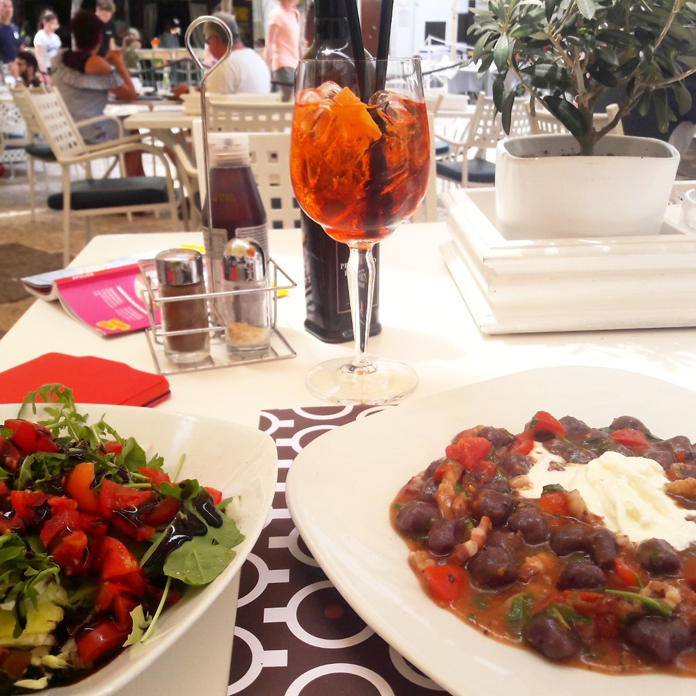 Aperol spritz, beetroot gnocchetti and salad