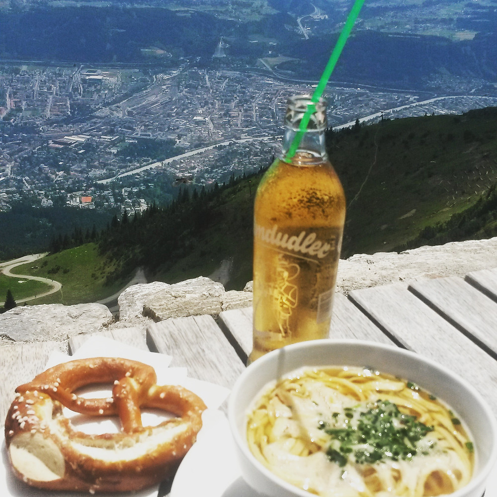 almdudler, prezel and pancake soup at the top of nordkette mountain in innsbruck