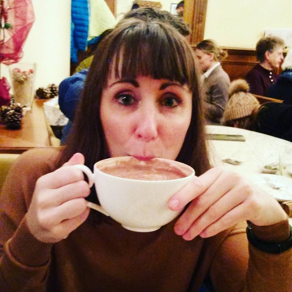woman drinking hot chocolate at caffe piemonte in munich