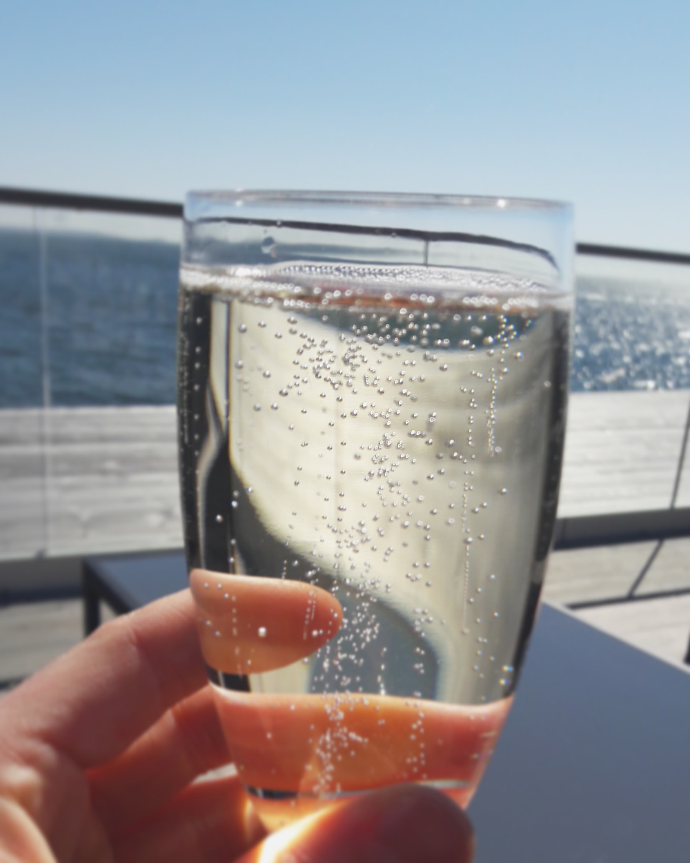 glass of prosecco by the sea in Helsinki