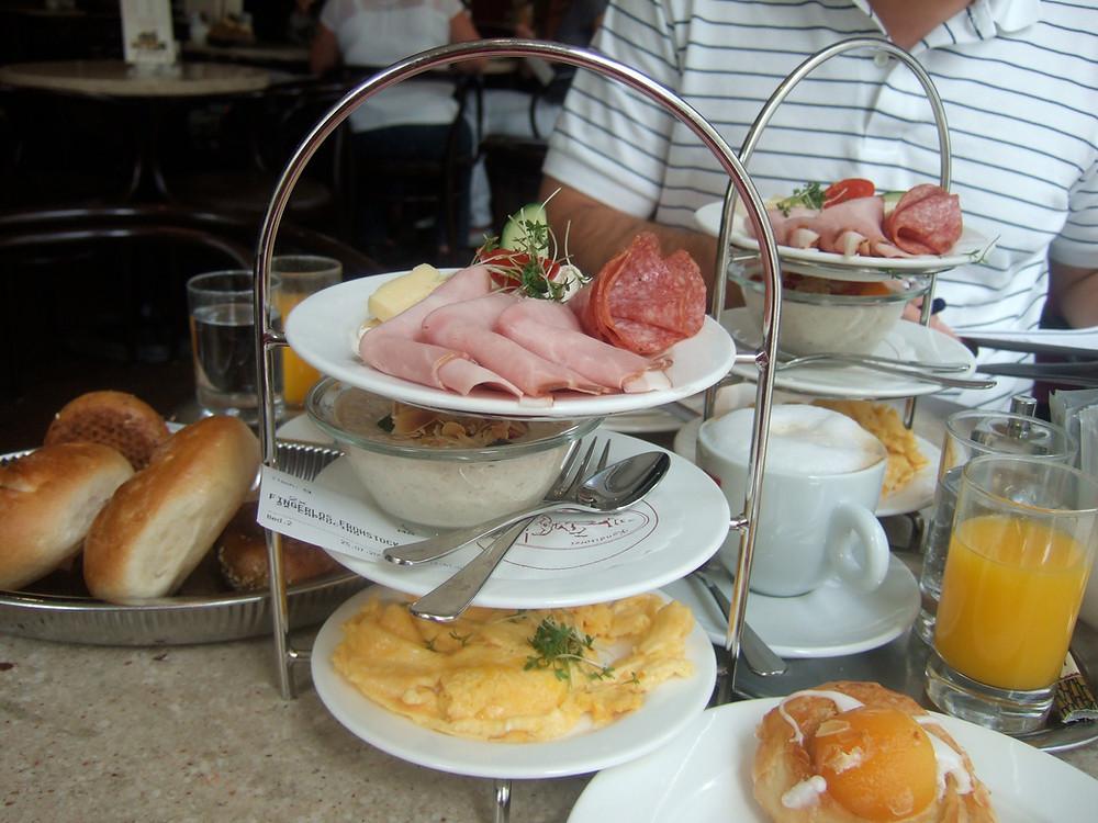 Breakfast tower: eggs, muesli, meat, bread