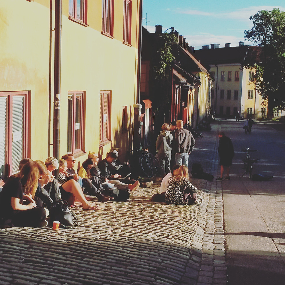 locals relaxing in the sunshine in Nytorget