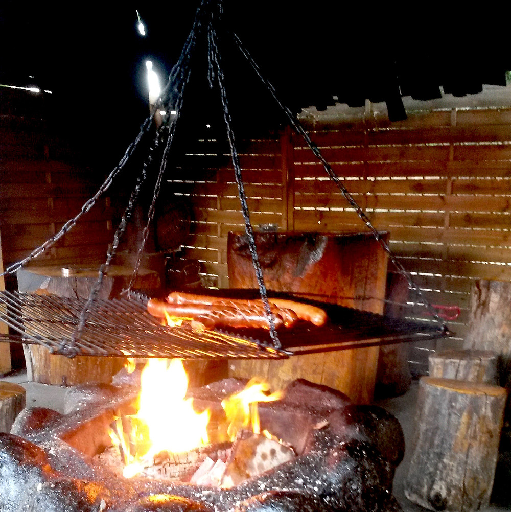 open fire with sausages Karczma Smil'y