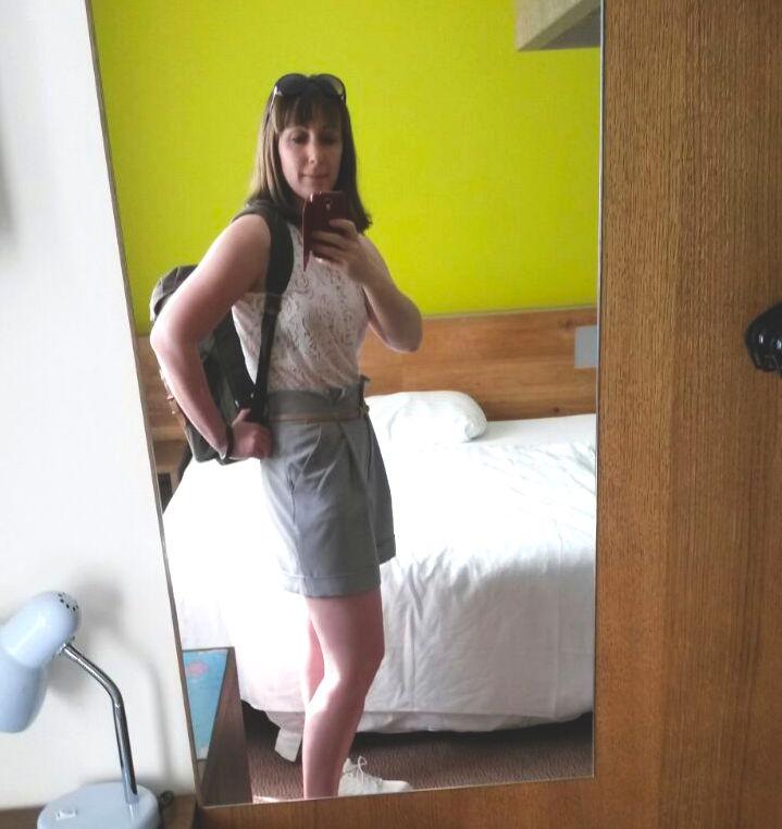 woman in basic hotel innsbruck room