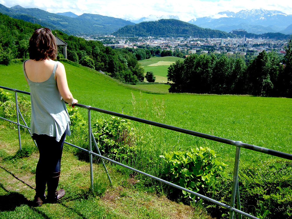 woman on top of Plainberg looking over towards Salzburg