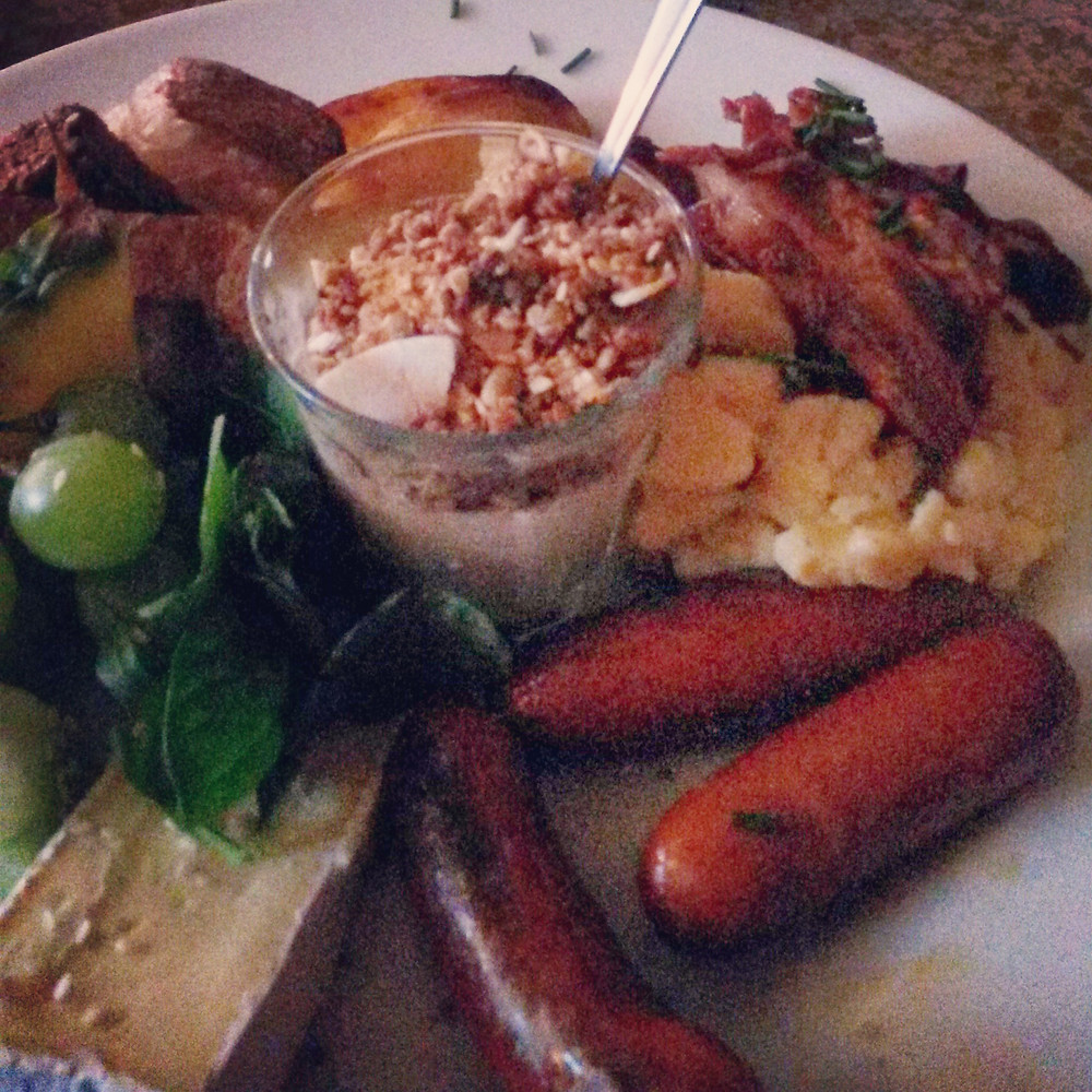 scrambled eggs, bacon, chili sausages, small oven baked potatoes. Brie, greens & fruits. Skyr with homemade roasted müsli