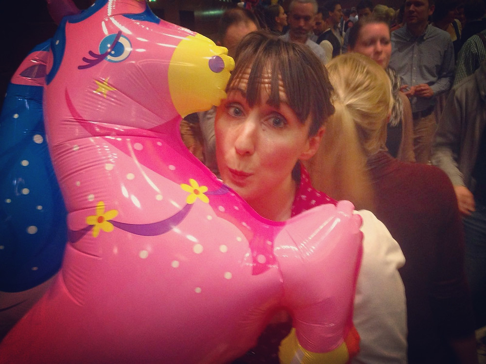woman with unicorn balloon at Starbierfest in Munich