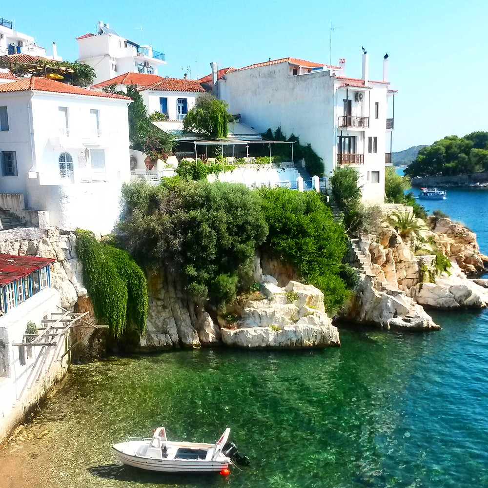 little cove and boat near skiathos town