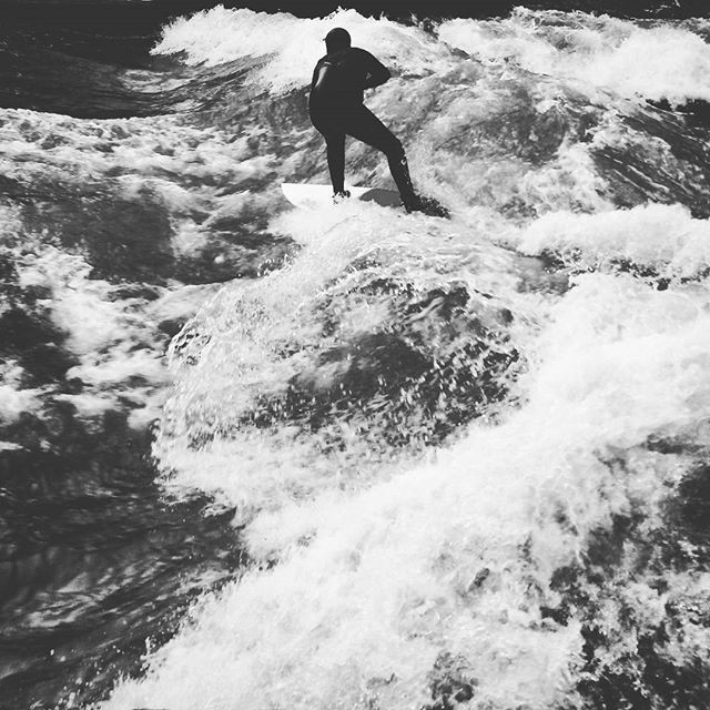 surfer on the eisbach in munich