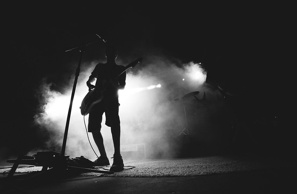 Silhouette of musician on stage