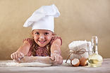 Happy little chef smeary with flour stre