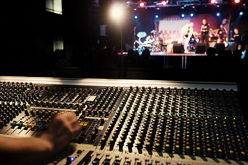 sound board with stage in background
