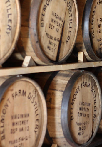 Barrels of whiskey aging
