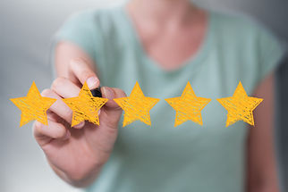 Businesswoman on blurred background rating with hand drawn stars.jpg