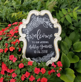 White framed wedding chalkboard with floral illustrations
