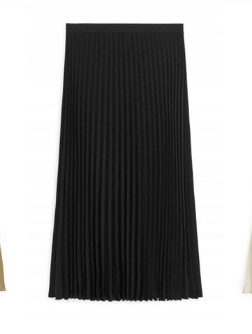 11 plisserade kjolar vi gärna bär i höst