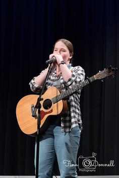 Emma on Harmonica