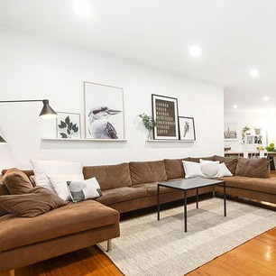 Staging a house to sell using owner's existing couch.