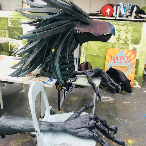 Full bird head with claws