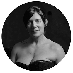 Black and white image of mature woman in corset.