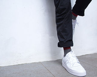 White wall and trainers with cool socks