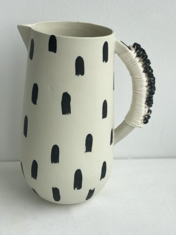 tall black/white jug