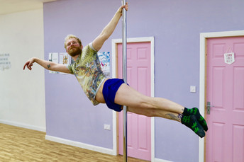 Andrew doing superman pole