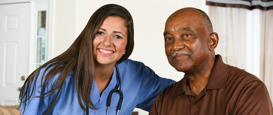 Health care worker helping an elderly pa