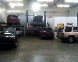 clean auto shop with lifts