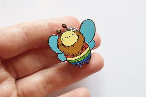 Reba the rainbow bee enamel pin