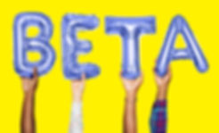 Hands holding beta word in balloon lette