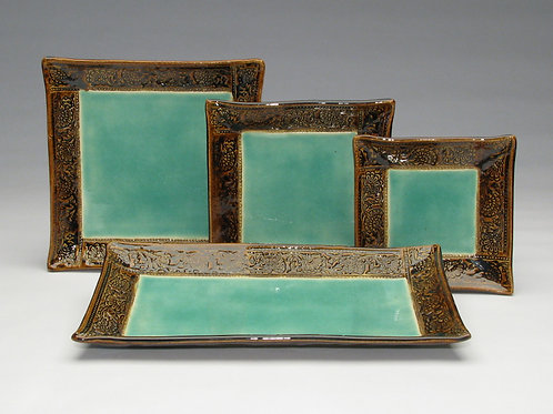 Set of four Bali Collection plates and trays