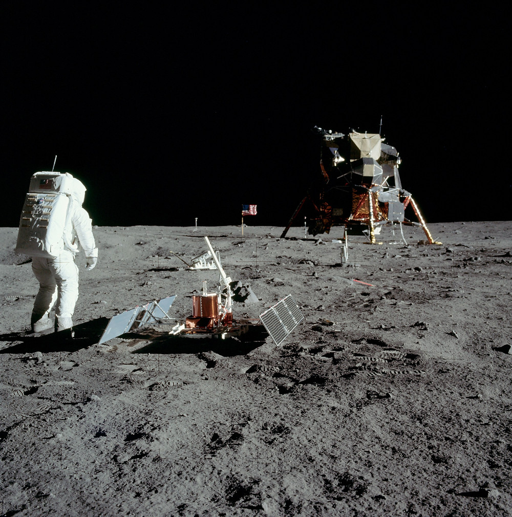 Buzz Aldrin, seismic experiment, and the lunar lander.