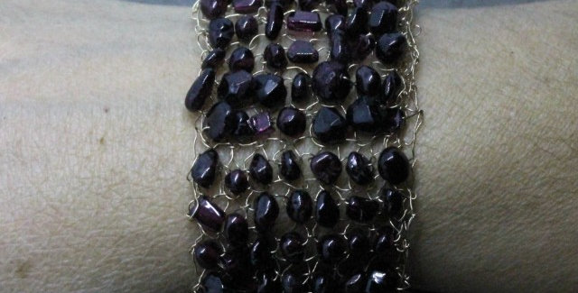 Hand Knitted Gold Bracelet with Garnets
