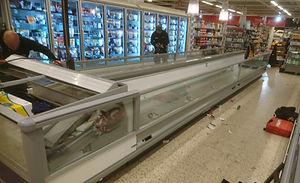 Montering/installation av en frysdisk i en butik