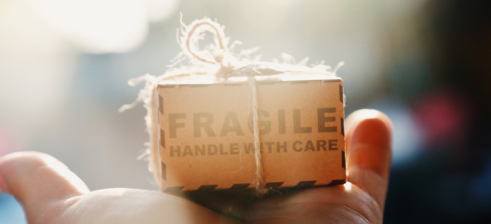 Author writer how to get traditionally published fragile handle with care tiny important package delivery