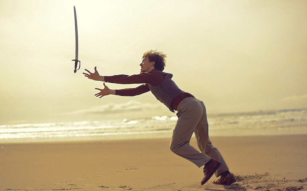 Falling and failing miserably on the beach with a sword.