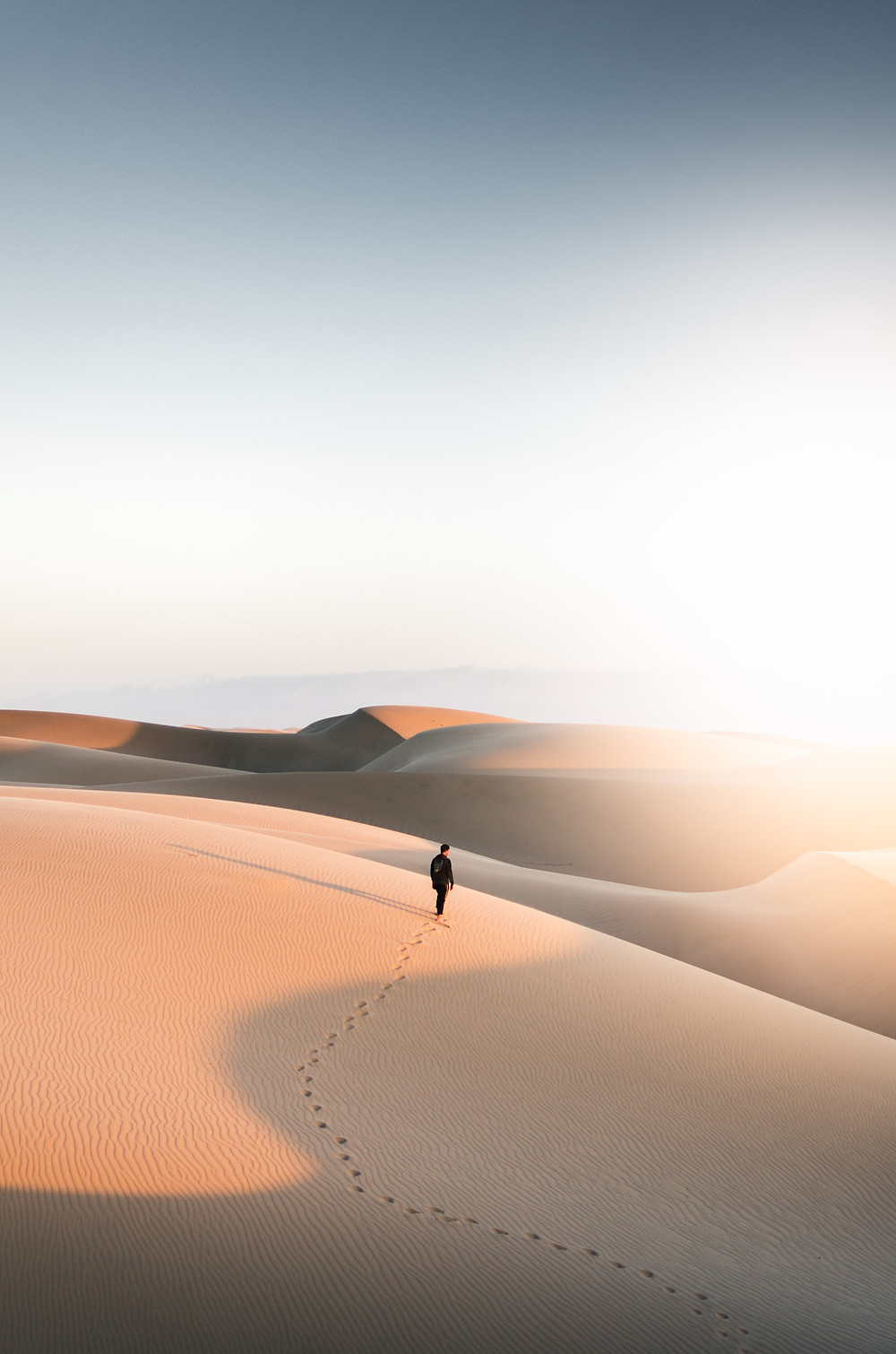 how to get a secret literary agent publishing publish your manuscript man walking through desert footsteps in sand