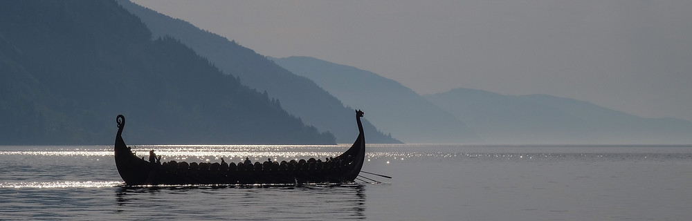 How to get published as a writer author traditional publishing viking warship in fiord beautiful morning evening afternoon longship on water rowing