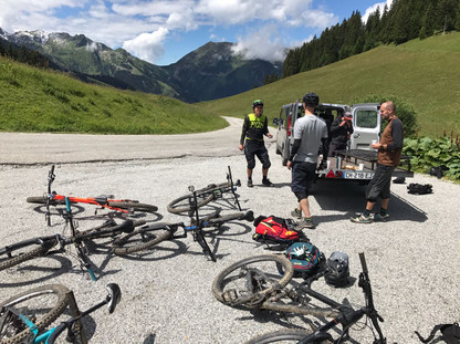 Getting the bikes off the shuttle van and preparing for an awesome descent