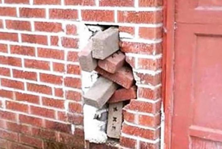 bricks stuffed in wall meme