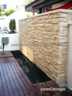 Craftstone feature wall with pond