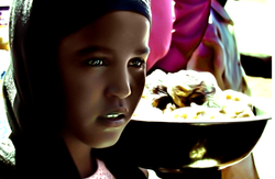 Young girl selling refreshments
