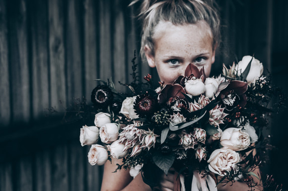girl holding wedding bouquet of flowers