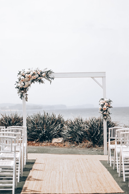 pretty pastel flowers on wedding arch at long reef