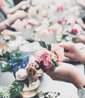 hands making flower crown