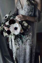 bride holding wedding flowers