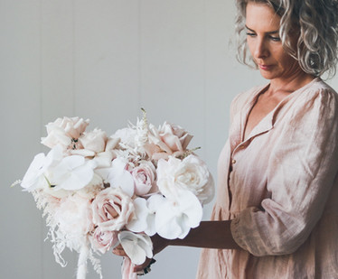 sydney florist holding bouquet of phalenopsis orchids and roses